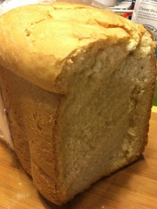 Loaf of sandwich bread with slice removed.