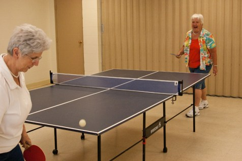 Fleurette and her close friend Shirley Ross play a spirited game of ping-pong at the Trafton Senior Center in Sanford, ME. The two women have been friends for almost 50 years and went through volunteer training at Hospice of Southern Maine together in September 2000.