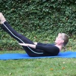 woman doing pilates hundred outside