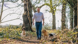 Cheshire Gundogs Chris with dogs in woods