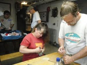 Lynn and Drew work chip paint off light fixtures