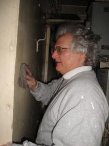 Paula prepping walls of fidley.