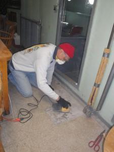 Tony sanding the floor in the wardroom.