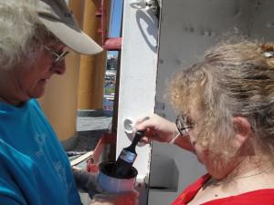 Photo by Anne Puppa Paula Liebrecht and Heidi Moser working on damage control locker.