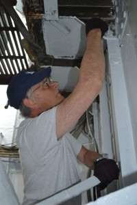 Tony painting electrical bracket in Fidley.