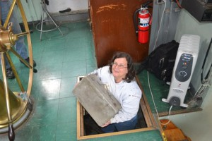 Anne Puppa stowing some equipment below the pilothouse.