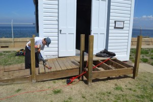 Carolyn removing boards form ramp.