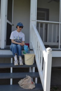 Sue Edwards cleaning the duplex porches