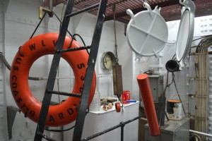 Hanging art…well actually its the light and ship dark covers and life ring drying in the fidley.