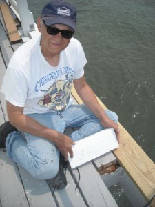 Tony working on replacing deck board.