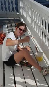 Claudia painting railing