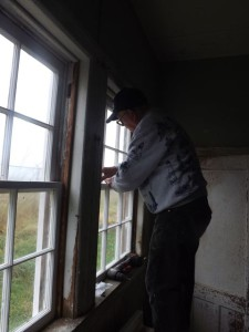 Hobie works on Buoy Shed window.