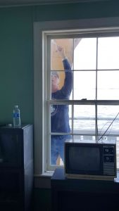 Jeff painting exterior window.
