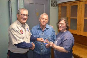 Hobie receives his 1000 hour volunteer patch.