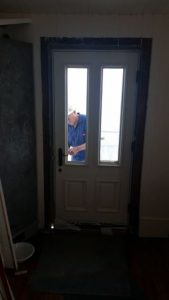 Bob Stevenson works on kitchen door lock.