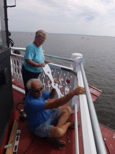 Cathy & Captain Howard work on new cupola railing