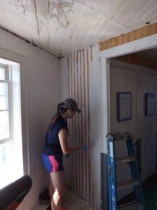 Daniella Blyakhman paints new siding in the equipment room