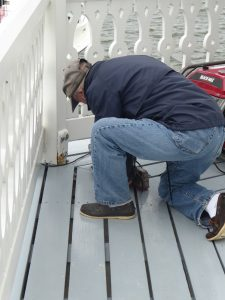 Dick repairing deck.