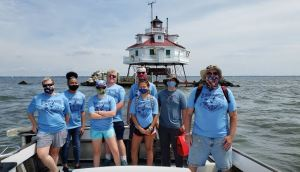 Sea Scouts head home after a day at Thomas Point. L-R Tina C, Jalyn HM, Kaitlyn K, James M, Ian O (back), Izzy F (front),Quinn S, Pat O