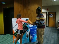 FSU Cheerleader, Jessica Taylor and Football team member Anthony Nixon selecting name for prizes