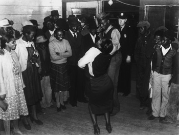 """Dancing the Lindy. Woman dancing the Lindy, also known as the jitterbug, at a juke joint in Clarksdale, Mississippi, on a Saturday afternoon in November 1939. Photograph by Marion Post Wolcott."""