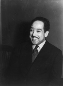 """Langston Hughes. A portrait of the author in Paris in 1938."""