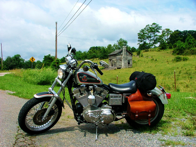 My Sportster and the little log cabin on RT. 70.
