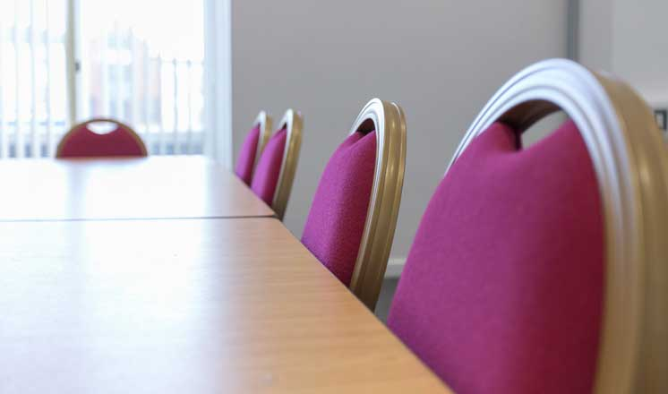 Red padded seating in Meeting Room 2 at the Assmebly Rooms