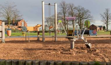 Play equipment and sand at Eastwood Park where Hasland Village Hall is located.