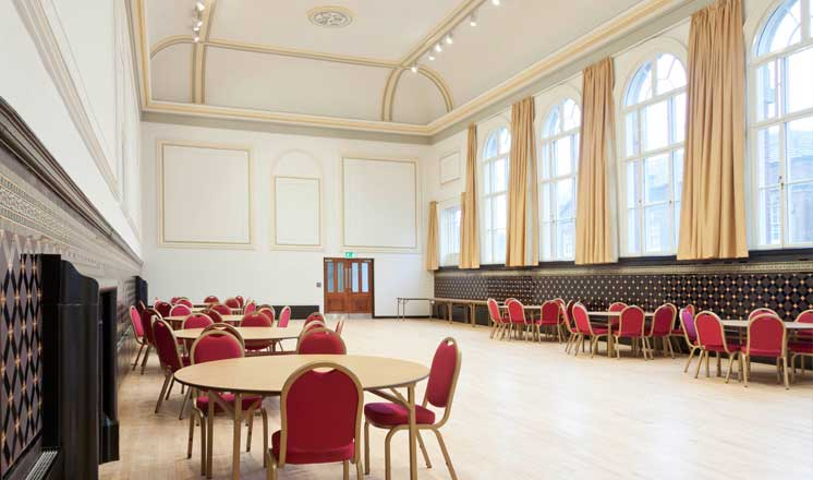 The Main Hall at the Assembly Rooms with tables set up along each side of the room.