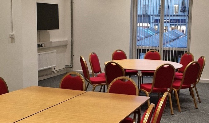 Meeting Room 2 at the Assembly Rooms set up with two tables.