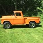 Orange 1957 Chevy 3100.