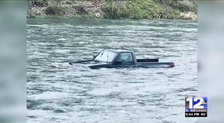 GMC Sierra in an Oregon river