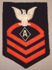 """This dress blue Specialist """"A"""" rating badge was used for the Navy's Athletic Instructor specialist rating from 1942-1944 then as the Physical Training Instructor from 1944-1948."""