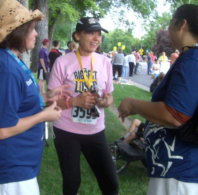 Deni Hill chats with fans after a 5K walk in Salt Lake City.