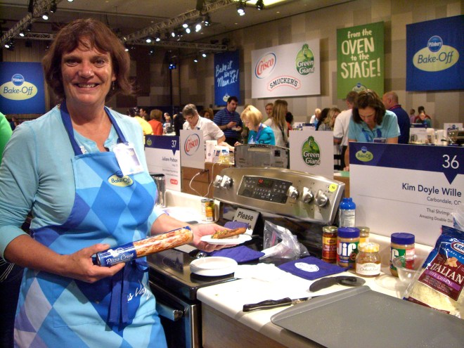 Kim Doyle Wille of Colorado at the Pillsbury Bake-off, offering samples of her Thai Shrimp Pizza.