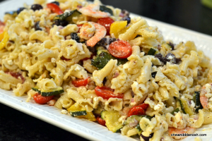 Green Pasta Salad with Shrimp Tomatoes Zucchini Peppers and Feta - Chew Nibble Nosh