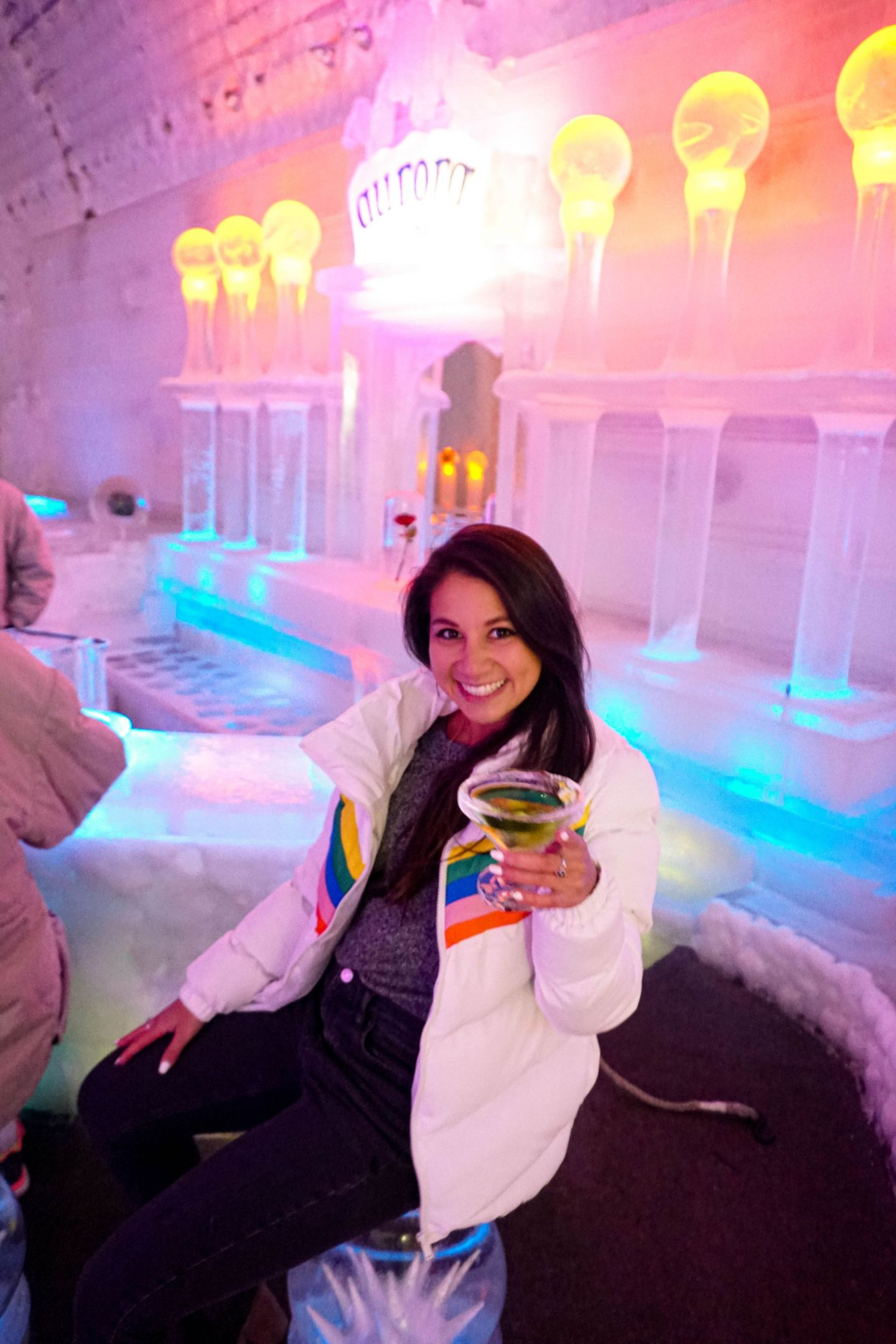 Enjoying a signature cocktail in Chena Hot Springs Resort's ice museum.
