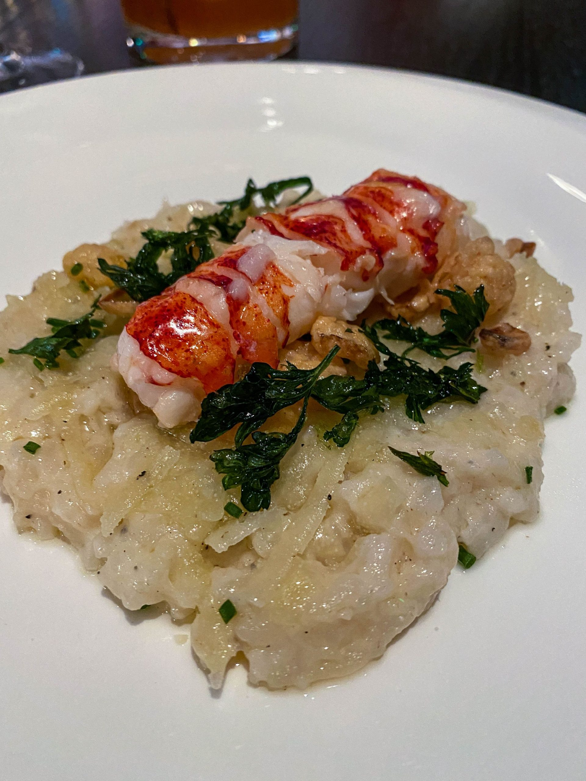 Lobster Risotto with butter-poached lobster tail, truffle risotto, crispy onions