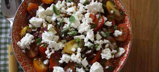 Small tomatoes mixed with fresh oregano, olive oil, red onion and topped with crumbled feta. This makes a simple salad that's big on flavour.