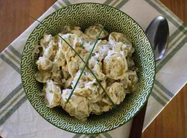 This garlic and tarragon potato salad is an easy side dish for summer which can be made ahead of time. it is best served at room temperature.