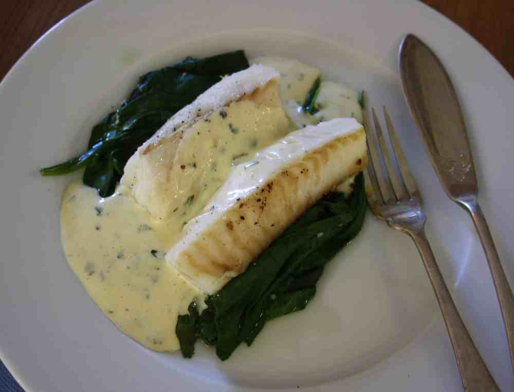 Cod on a bed of spinach simply roasted in the oven and served with a Mousseline sauce which is flavoured with basil.