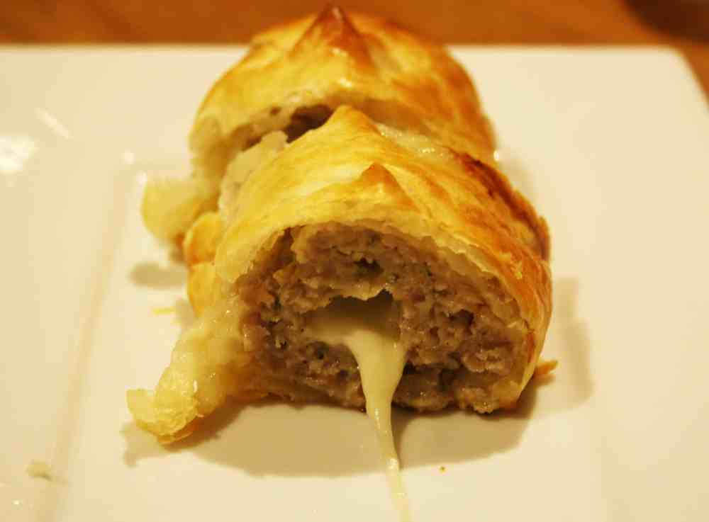 Mozzarella Sausage Rolls. Known here as Mooing Pigs, these naughty morsels are stuffed with mozzarella and when you cut them the mozzarella oozes out.