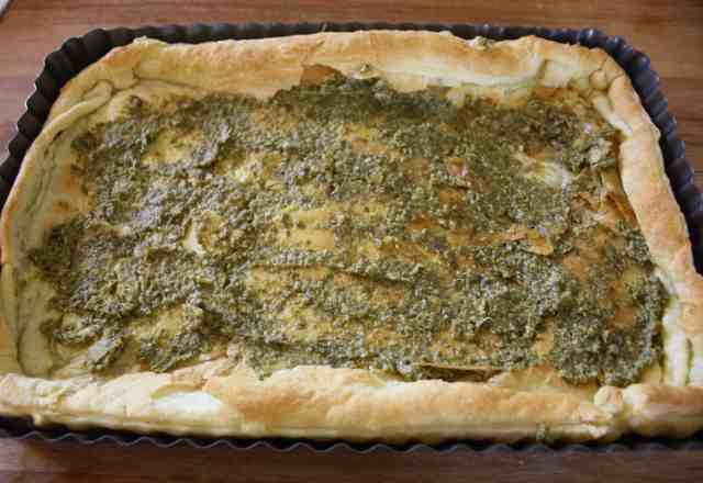 Roasted Asparagus Tart. Oven roasted asparagus and vine tomatoes are layered on pesto covered puff pastry before being covered with mozzarella and baked.