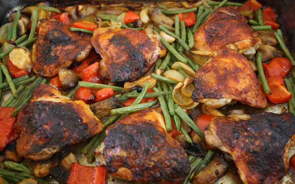 Baked Harissa Chicken. A simple one pot dish of chicken marinated in harissa and honey then roasted in the oven with peppers, onions and mushrooms.