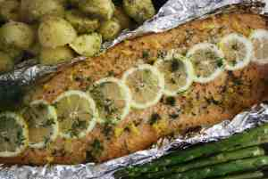 Honey Garlic Salmon. Delicious combination of butter, honey, garlic and lemon spread over salmon, baked and then grilled.