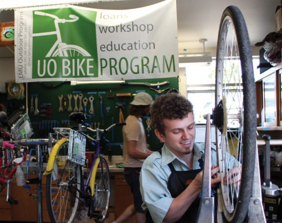 "Student bike mechanics from the University of Oregon Bike Program work on the program's bicycle fleet in their on-campus facility, affectionately known as ""the Barn."" Photo: Briana Orr"