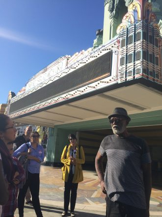 A longtime Leimert Park resident leads Untokening participants on a tour of the neighborhood. Photo: Lynda Lopez