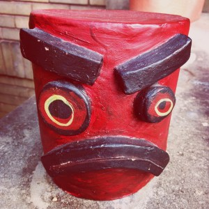 Ceramic robot head with angry expression