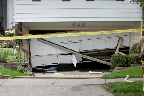 Buffalo grove haz mat spill for Drive through garage door